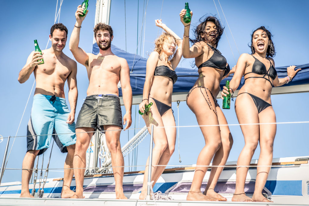 Young cheerful people having fun in boat party - Happy friends enjoying summer vacation