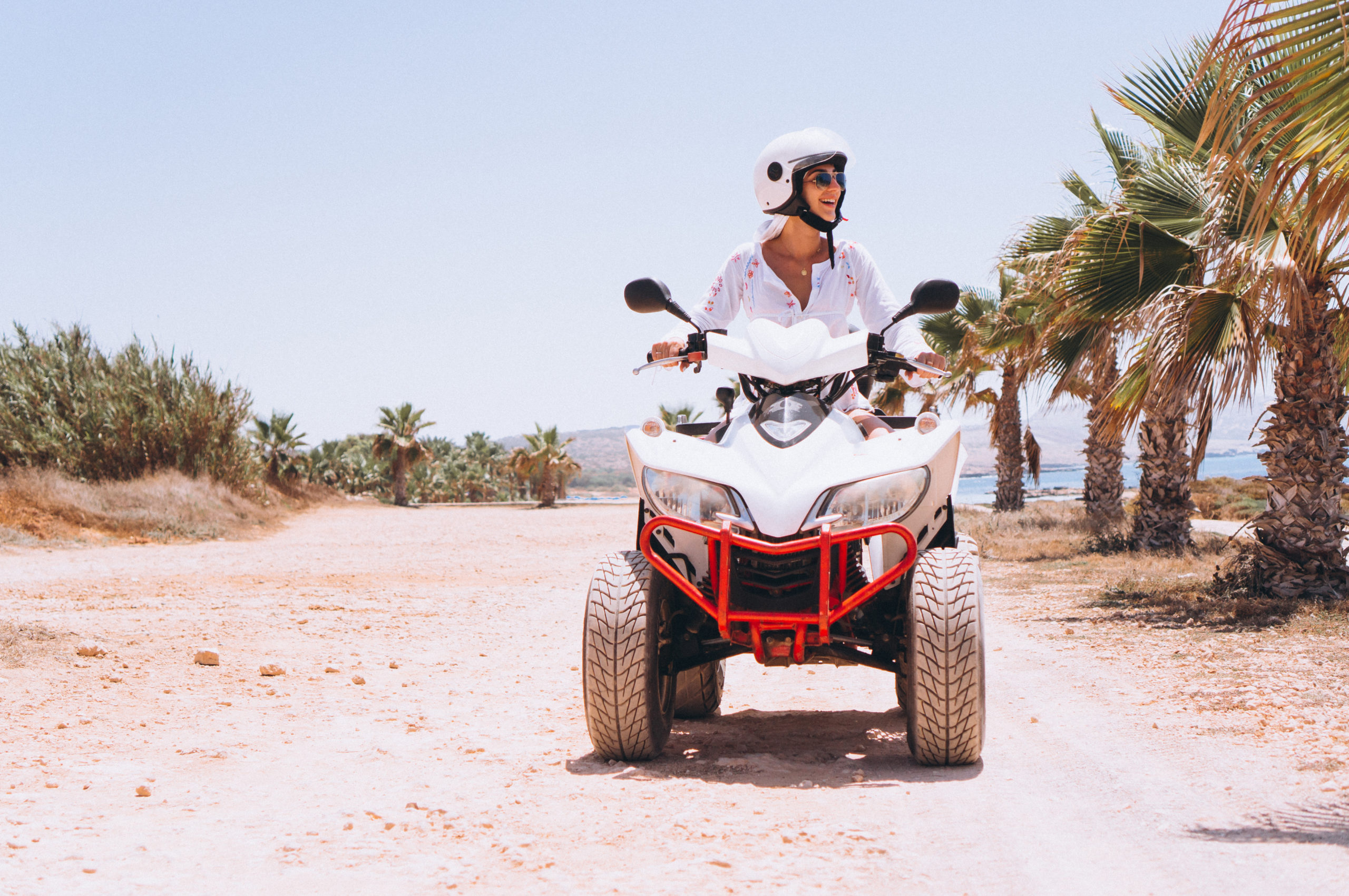 Woman travelling on quad by th ocean