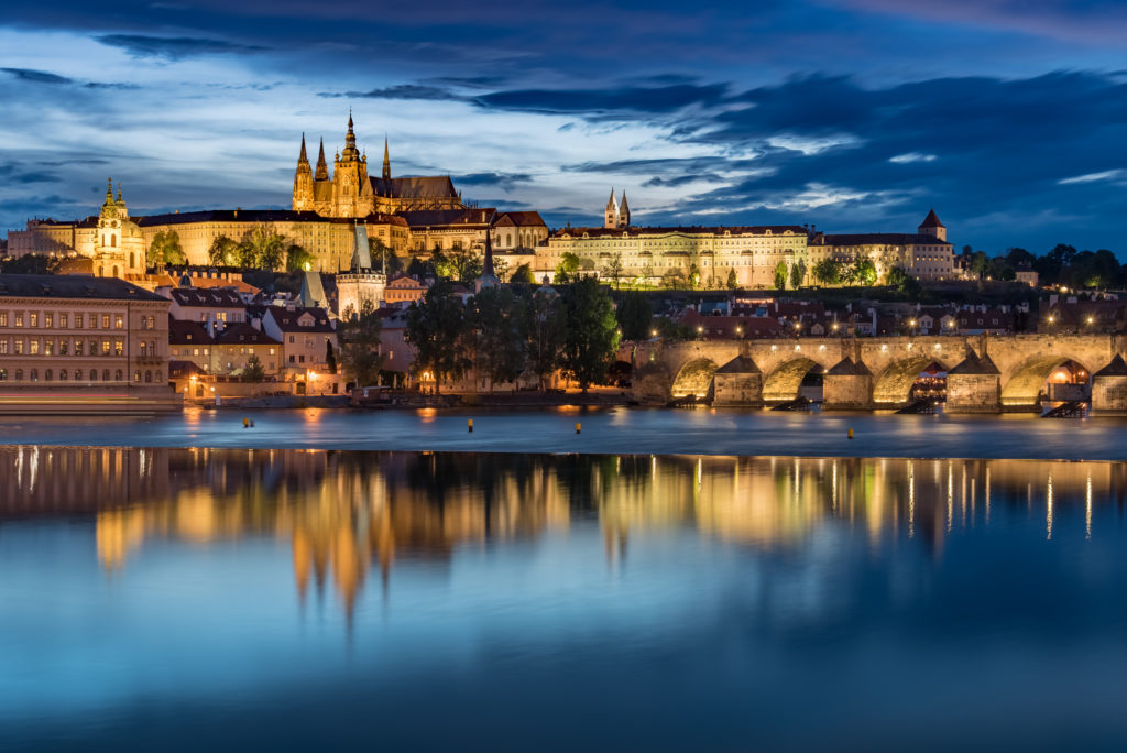 Prague Castle with cloudy sunset blue sky and Charles Bridge, Czech Republic