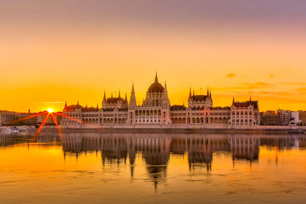 Sunset view of Budapest Parliament building with Danube River in Hungary