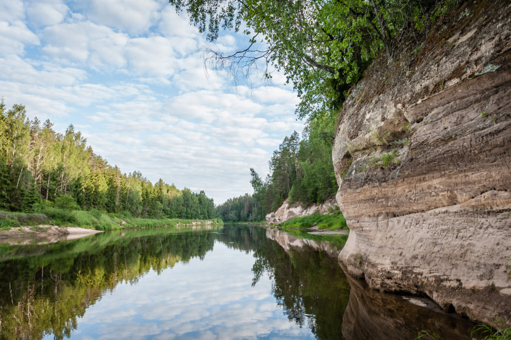 Peaceful landscape with Gauja river and white sandstone (Sietiniezis) outcrops. Gauja National Park. Latvia. Baltic.