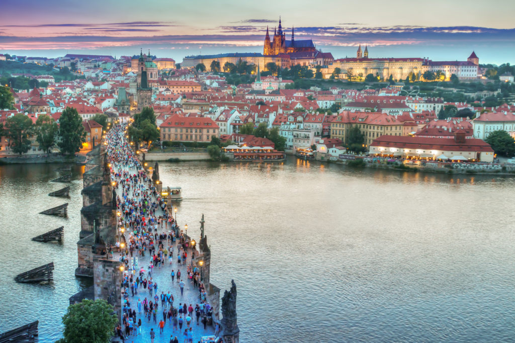 Evening in the historic center of Prague and view on the Charles Bridge