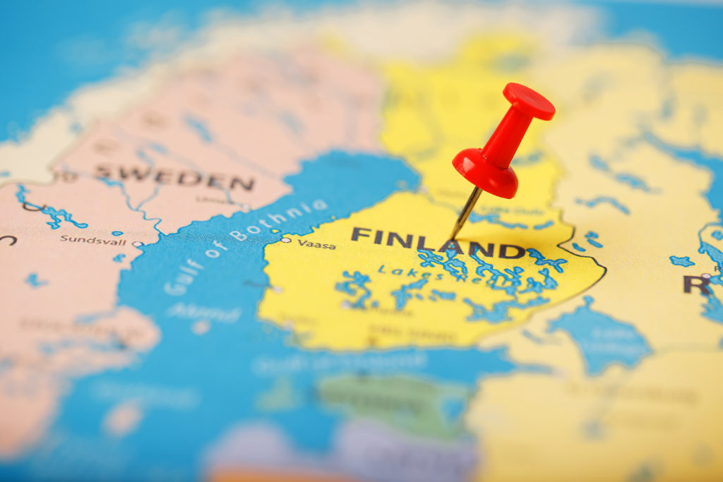 The location of the destination on the map of Finland is indicated by a red pushpin. Finland is marked on the map with a red button
