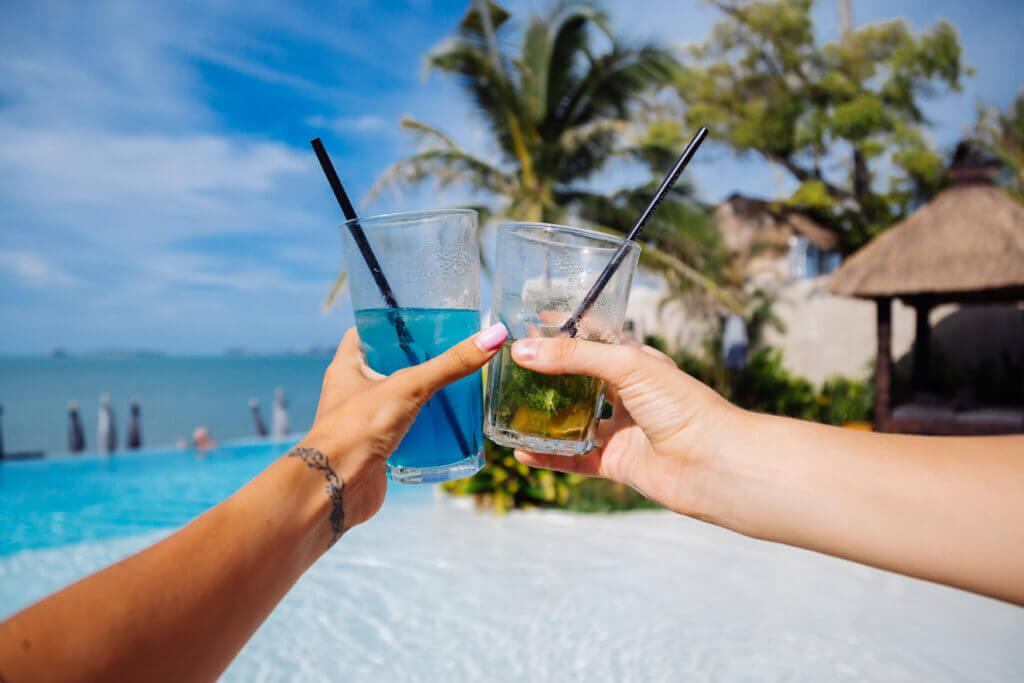 close-shot-hands-hold-alcohol-cocktails