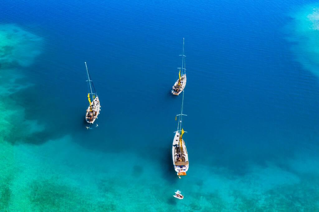 Yachts in the bay near the green island. Summer vacation, Greece, Kefalonia